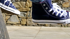 Close up detail view of a skater feet riding his skate board Stock Footage