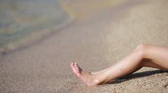 Female legs on white sand beach Stock Footage