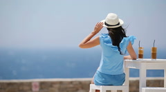 Young woman drinking cold coffee enjoying sea view. Beautiful woman relax during Stock Footage