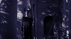 Horned witch ghost walks through the ruins of the castle. halloween Horror Stock Footage