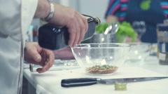 The chef prepares a marinade for the roast beef. Olive oil Stock Footage