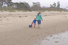 Grandma and her Grandchild on the Beach Stock Photos