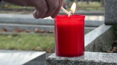 Cemetry light a candle Stock Footage