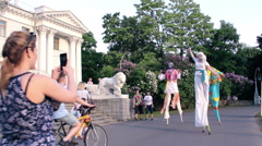 People Taking Pictures on Smartphones Street Performers on Stilts Stock Footage