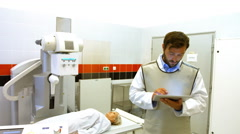Male doctor using digital tablet in x-ray room Stock Footage