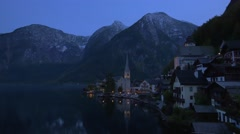 View of Hallstatt at Hallstatt lake at dusk in Austria Stock Footage