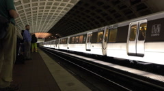 Train exits L'Enfant Plaza Metro stop in Washington DC Stock Footage