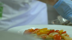 Chief baked fish with vegetables on white a plate Stock Footage