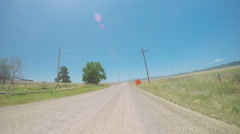 Car driving on rural paved road in South Denver, near Chatfield State Park.-POV  Stock Footage