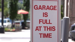 Garage is full at this time sign on busy downtown city street 4k Stock Footage