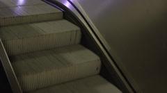 Escalator running downwards at night Stock Footage