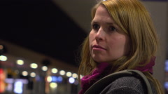 Girl waiting for train at station during night hours 4k Stock Footage
