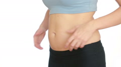 Woman fat belly. vacuum massage of the abdomen. girl pulls the stomach Stock Footage