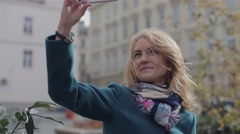 Girl Recieve Videocall.Happy woman having a videocall on smartphone in the city Stock Footage