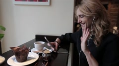 Girl Recieve Videocall.Happy woman having a videocall on smartphone in cafe Stock Footage