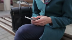 Young woman using her touch screen mobile cell phone Stock Footage
