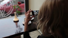 Attractive young woman Photographing food in restuarant cafe. closus-up Stock Footage