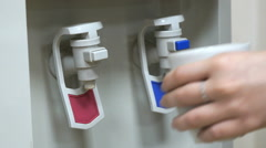 Cooler of drinking water mounted at the office Stock Footage