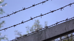 Fence with barbwire protecting from intruders 4k Stock Footage