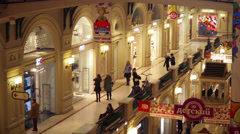 People walking across Trading rows in Moscow GUM shop Stock Footage