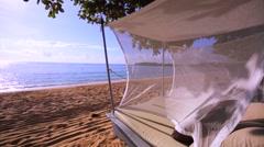 Nusa Dua beach. Gazebo on the beach daytime. Ocean surf. Closeup. Stock Footage