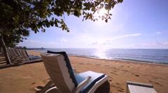 Nusa Dua beach. Deck chairds on a beach near the hotel at the morning. Ocean Stock Footage