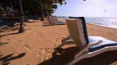 Nusa Dua beach. Deck chairs on a beach near the hotel at the morning. Ocean Stock Footage