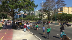 Crowds of people waiting for Olympic torch carrier to arrive Rio 2016 4k Stock Footage