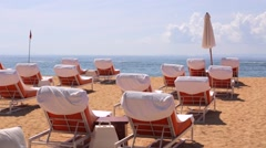 Nusa Dua beach famous luxury place for vacation. Rows of deck chairs on a beach. Stock Footage