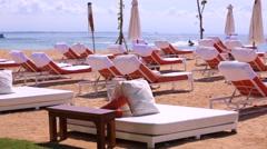 Nusa Dua beach. Rows of deck chairs on a beach. Tourist cruises on a jet ski Stock Footage