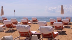 Nusa Dua beach. Rows of deck chairs. Ship and boat in the ocean on background. Stock Footage