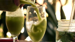 Pouring green, healthy juice into glass, super slow motion Stock Footage