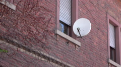Satellite dish on window exterior of apartment 4k Stock Footage