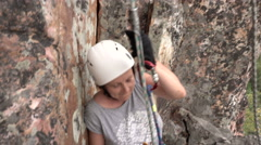 Female Climber Climbing a Rope on a Rock.sunny Day. Summer Stock Footage