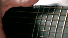 Man's hand touching guitar strings. Music performance. Super slow motion macro Stock Footage
