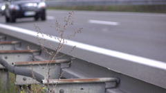 Highway guide rail with traffic going by in background 4k Stock Footage