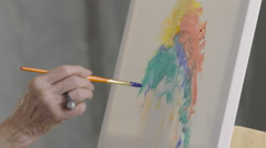 Close up of a woman's hand painting an abstract painting Stock Footage