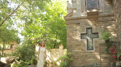 Girl in a white dress walks in gothic church. tourist attractions looks Stock Footage