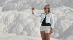 Cheerful girl photographed themselves use a smartphone in the historical site of Stock Footage