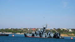 Bird flying over warship in the Sevastopol port. The Russian fleet. Crimea. Stock Footage