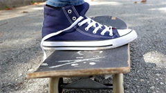 Close up detail view of a skater tying his shoes and riding skate board Stock Footage