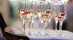 Many glasses of champagne at a party or wedding reception Stock Footage