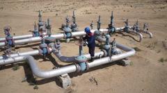 Oil Field Worker Turns Valve 60fps Stock Footage