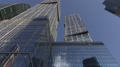Pair of supertall buildings, twin tower skyscraper at Moscow City, tilt down Stock Footage