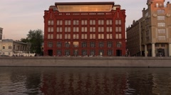 Brick building on river bank, former Red Textile Factory at evening time Stock Footage