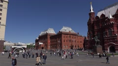 Manezhnaya Square panorama, pan to State Historical Museum, people stroll Stock Footage