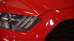 A head-on, close up shot of a car's headlight. Stock Footage