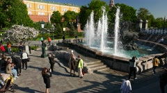 Citizens rest in Alexander garden park near Geyser fountain, sunny evening Stock Footage