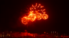Red explosions with sound, annual celebration salute at dormitory area Stock Footage
