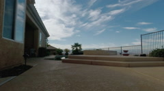 TIME LAPSE: Fast CLouds Over Patio/Pool Stock Footage